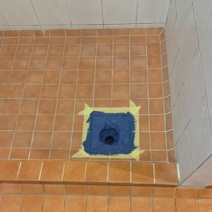 fix leaking floor waste in shower